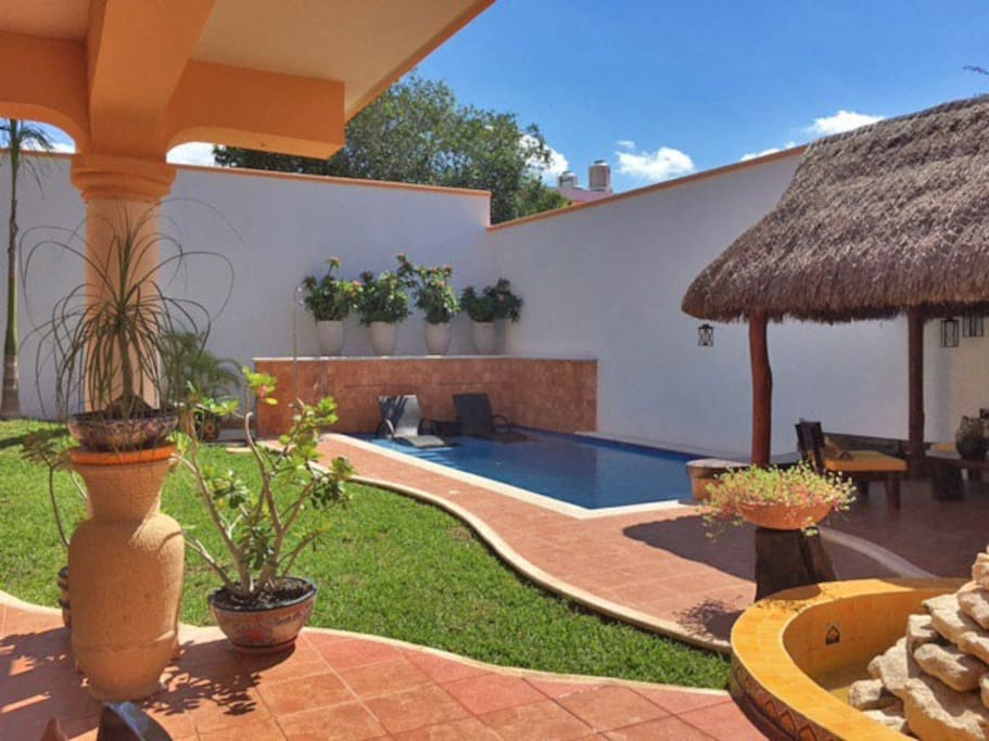 Downstairs palapa covered patio and swimming pool