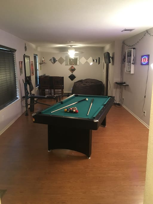 Game room, pool table, ping pong, music, Netflix, workout bench, darts!