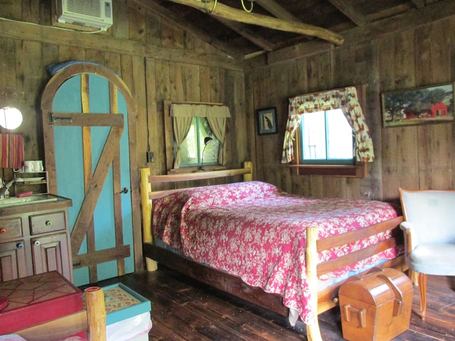 The barn has a queen bed, which was built from scratch using a tree that was cut from the property.