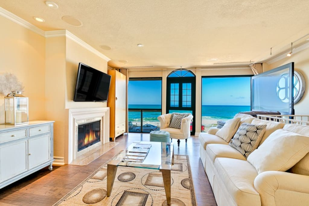 2nd Floor Living Room with Fireplace, Flat Screen TV and Expansive Ocean Views.
