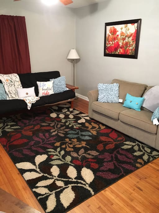 Comfy and cozy, double cushioned futon and pull out love seat. Both sleep 2.