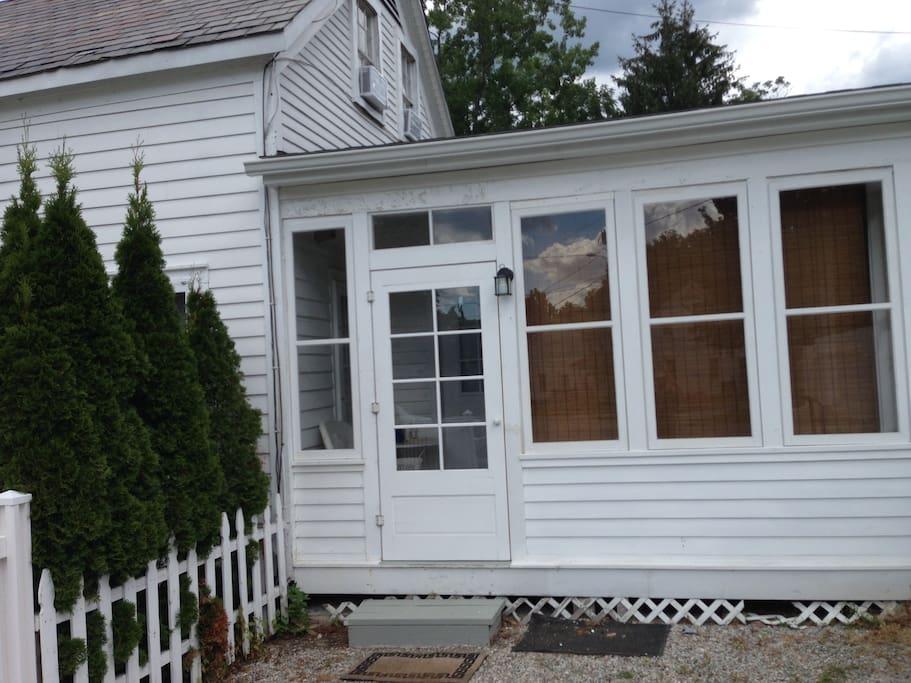 Enter through this closed-in porch