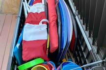 Storage for beach toys, including boogie boards, chairs, umbrellas, etc.