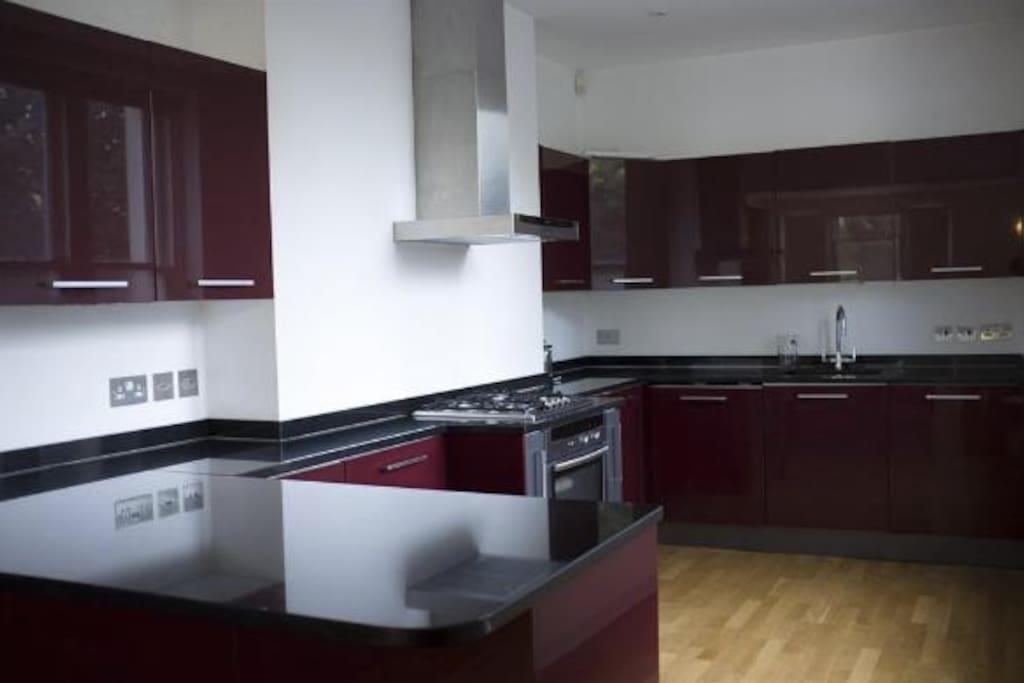 Large, modern kitchen with washing machine and dishwasher
