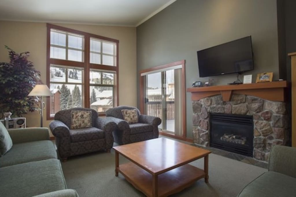 Watch a movie on the flat screen and warm up in front of the fireplace.