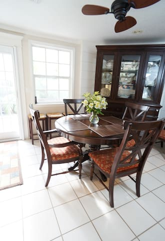 The dining room table has a leaf to expand it to seat up to eight. There are also six counter height stools to sit around either of the two kitchen islands.