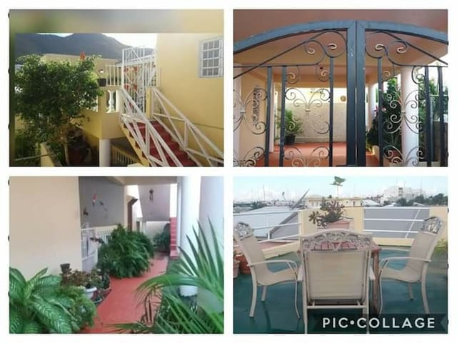 Gated bright, safe airy apartment with patio