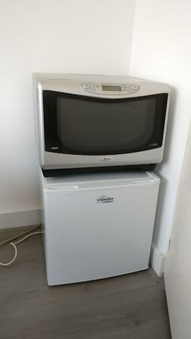 In the first bedroom we offer your a combo of a microwave and a hot air oven. To store some food, we offer a small fridge.