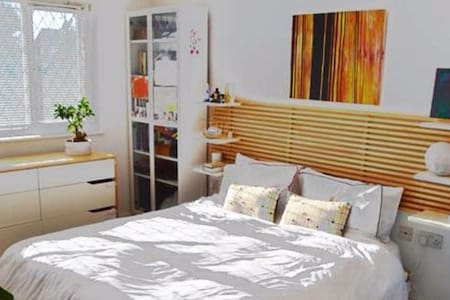 Modern king size bedroom perfect for a Staycation
