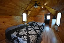 One of the Stunning Queen Cabins with 2 Queen Beds