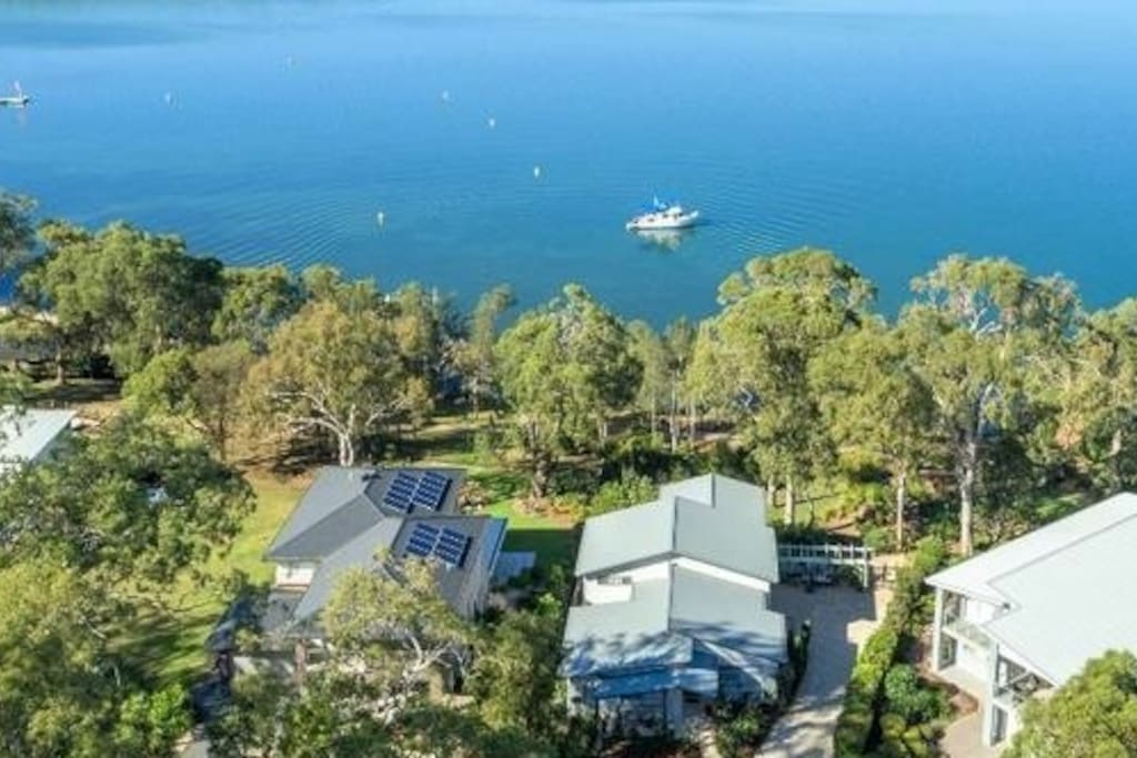 A bird's eye view of your waterfront self-contained unit and gardens