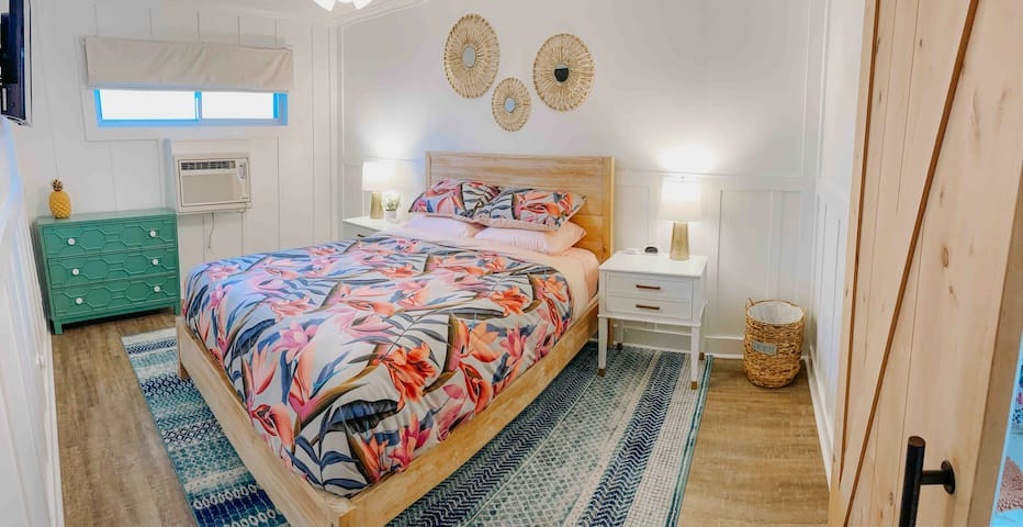 Master bedroom with a queen bed and dresser. Same bedroom with a different duvet comforter.