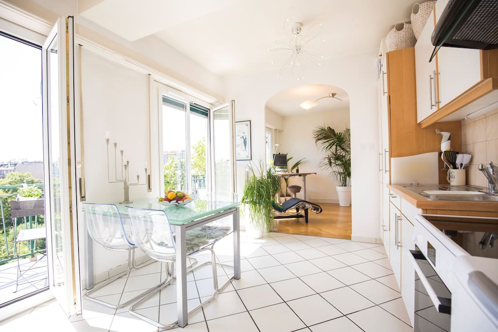 Kitchen with direct access to balcony and view to the Jura mountains