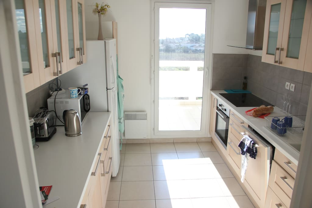 Fully equipped kitchen opens onto sun terrace
