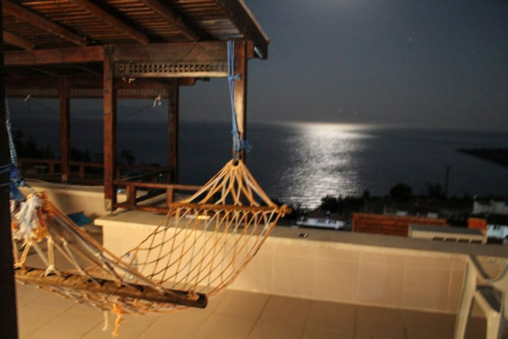 Relax on the hammack watching the moon reflect on the ocean