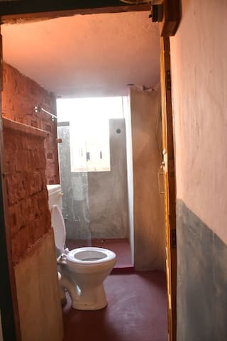 Bathroom 1 : Well aired and lit up with natural light, this space comes complete with modern amenities.