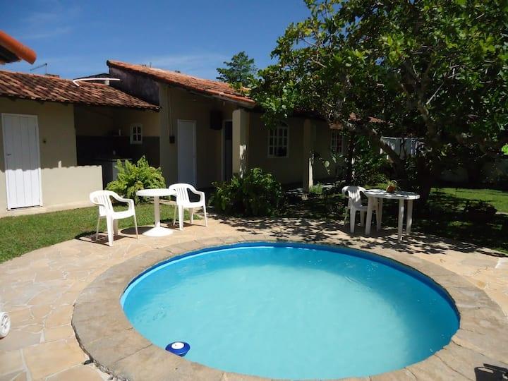 Casa com 4 Quartos com  ar condicionado, piscina.