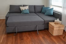 Bedding is stored in the lift-up sofa futon on the right of the unit.