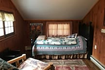 Bedroom with twin size bed and twin size futon