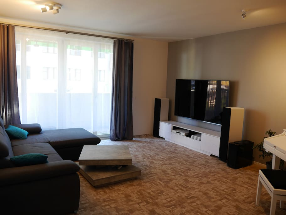 The living room with big TV, Big Hi-fi, Big piano, Big PS4... just big and ready for you :-)