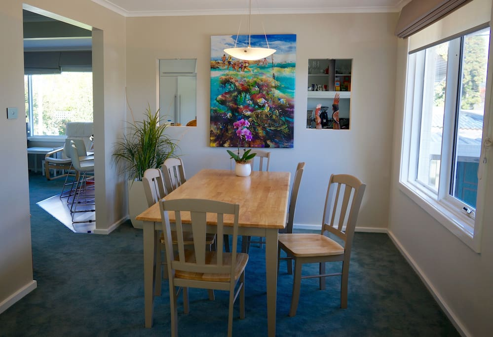 Dining room which flows onto the second living area and kitchen, and out onto the deck.