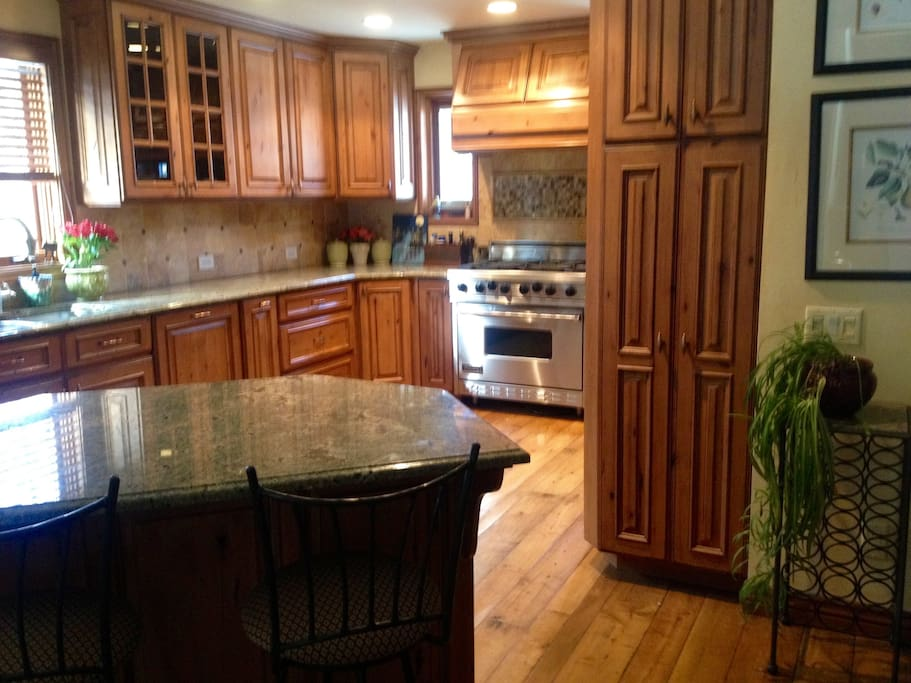 Beautiful, custom kitchen with granite countertops and tons of prep space. The six burner stove is great for prepping meals!.
