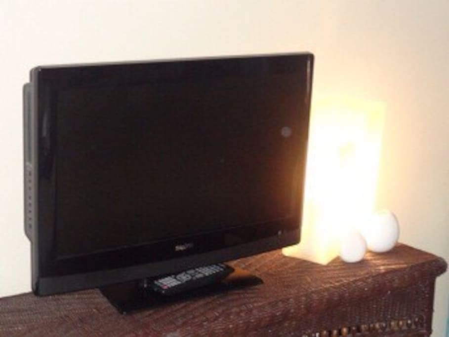 TV in bedroom and large flat screen in living room