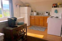 Kitchen with oven/stove and full refrigerator.