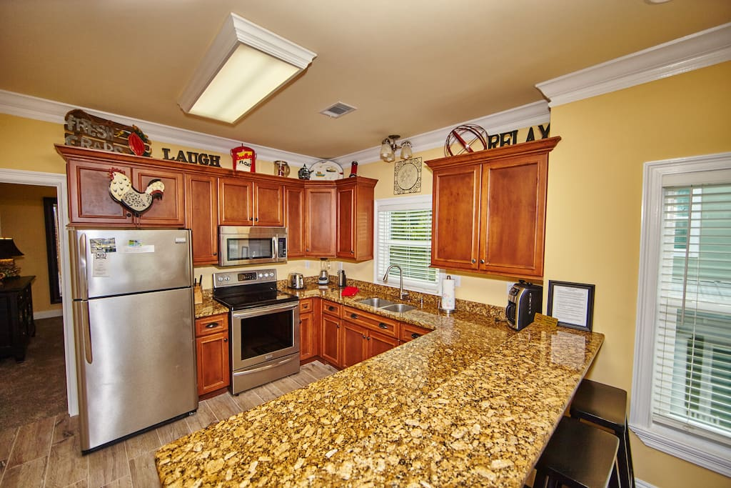 This is one of the 3 Kitchens which come stocked with everything you need & stainless steel appliances.
