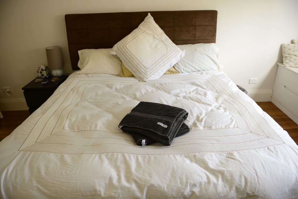 A super comfortable king-sized bed with Sheridan sheets and deliciously comfy pillows.