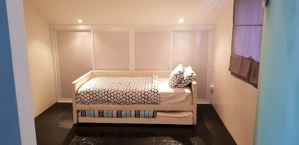 Bedroom 4 thats connected to the master bedrooms with a single bed and a pull out bed.