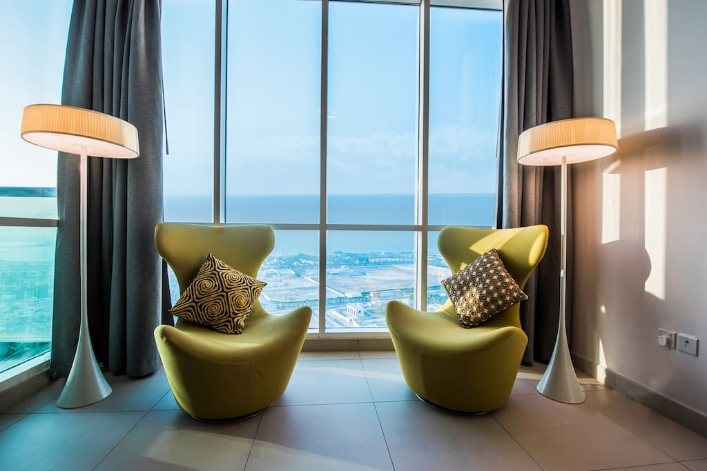Comfortable arm chairs overlooking Al sufouh area, Palm Jumeirah, King's Palaces and beach.