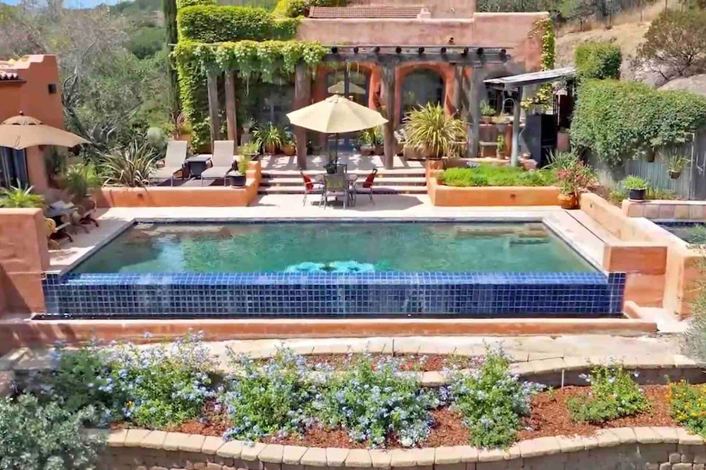 Extensive outside living space with lush vegetation and flowers. Infinity pool with heated spa' enjoy with entire home rental as well as private villa rental