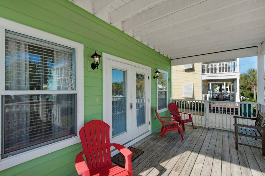 Great front porch with cheerful beach-y colors