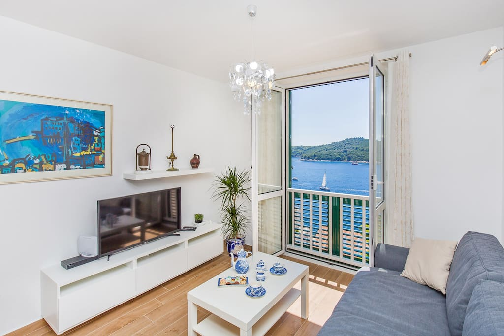 Sofa, TV and beautiful sea view.