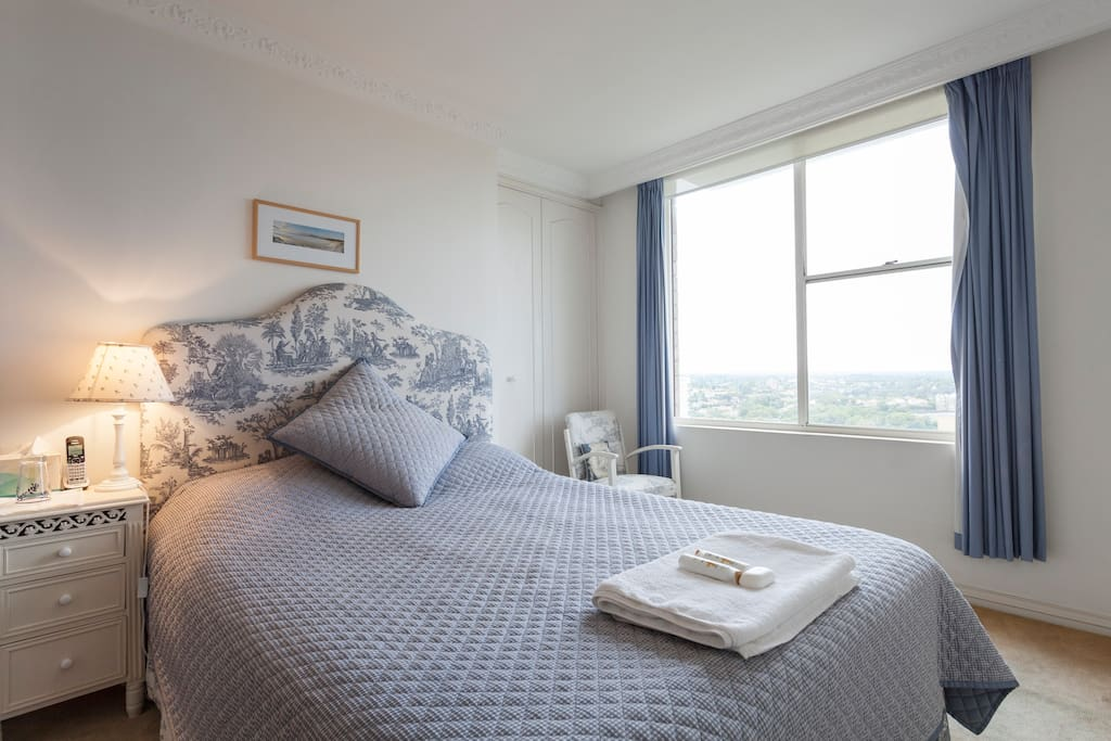 Comfortable queen size bed with views overlooking Middle Harbour and use of walk in wardrobe