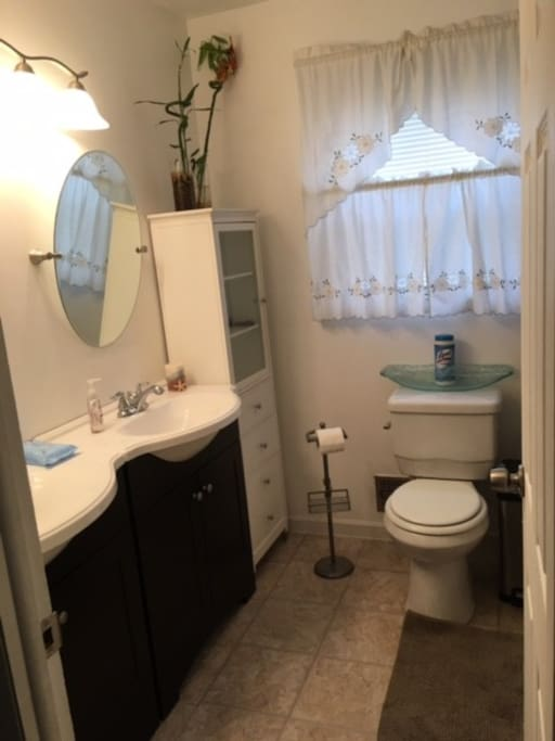Full bath with double sinks.