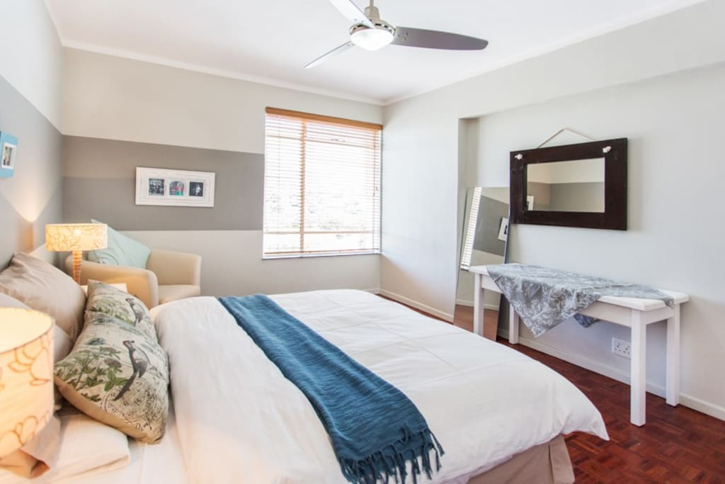Large bedroom with queen size bed and also with a view of Table Mountain.