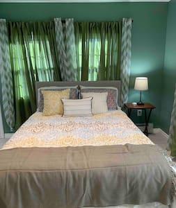 Very peaceful bedroom with  separate bathroom