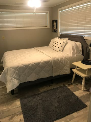 Queen size bed and room also features a flat screen TV.
