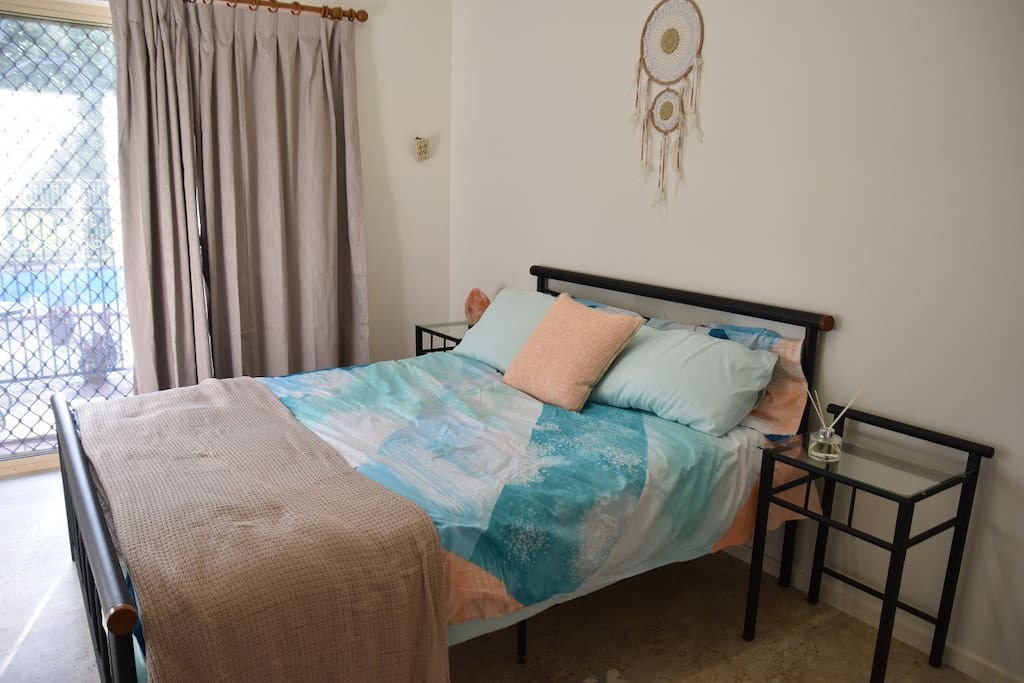 Queen size bed and bedside tables