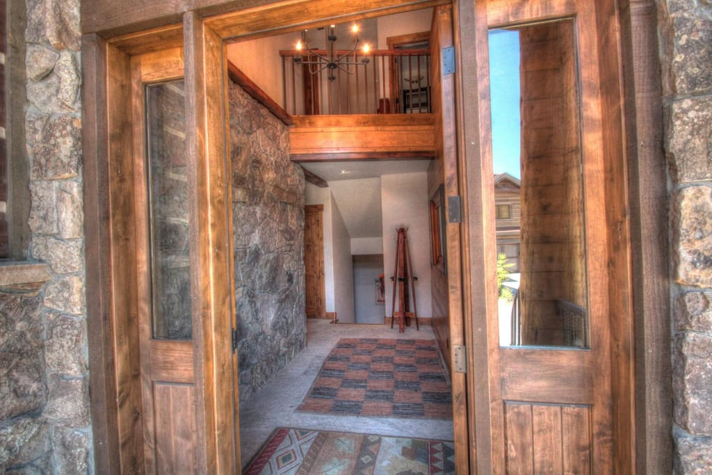 Mont Blanc Foyer - Impressive stone wall and entry way in this gorgeous foyer.