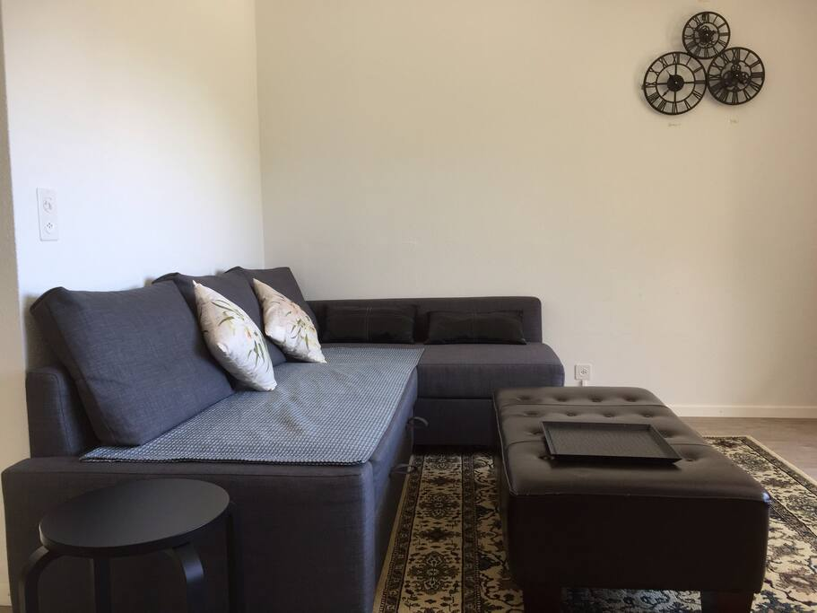 Spacious living room with a fantastic view and a double sofa bed