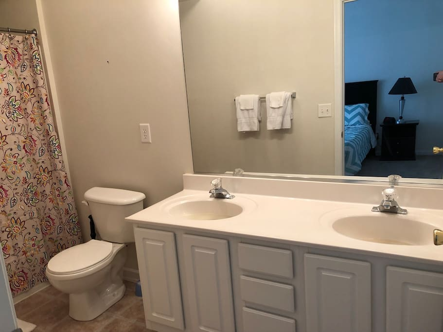 full bath with two sinks