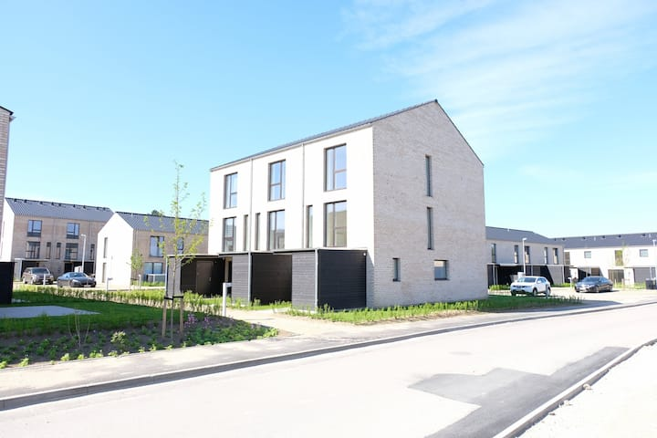 Newly built 3 bedroom modern row house in two stories with terrace and two bathrooms .