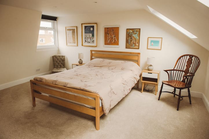Large, bright loft room with private bathroom
