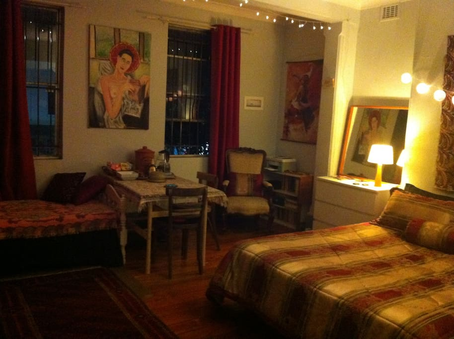 The room has seen a few rearrangements; it's sunny by day and glamorous at night.