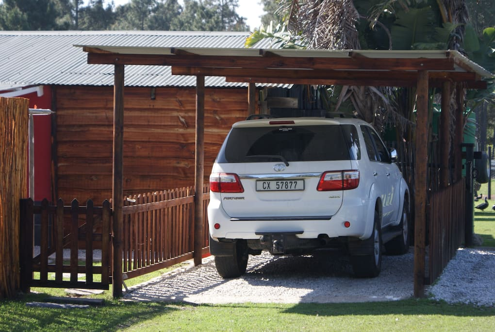 Sheltered Parking area & there is also an Open Parking Bay available for this Cottage
