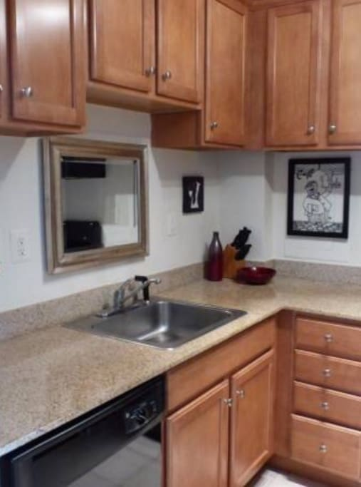 Fully equipped kitchen with gas stove, microwave and ice maker.