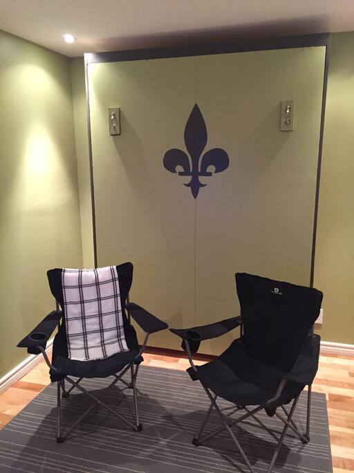Bedroom has Queen size Murphy bed that folds up and doubles as a tv room.